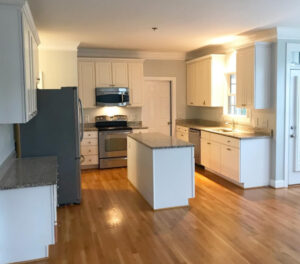 Image of a kitchen with white wooden countertops and cabinets